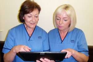 district-nurses-looking-at-ipad-e1474552259257
